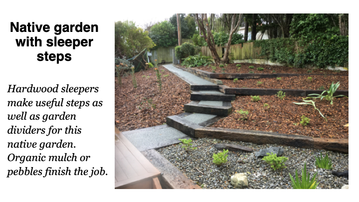 Native garden with sleeper steps - Hardwood sleepers make useful steps as well as garden dividers for this native garden. Organic mulch or pebbles finish the job.